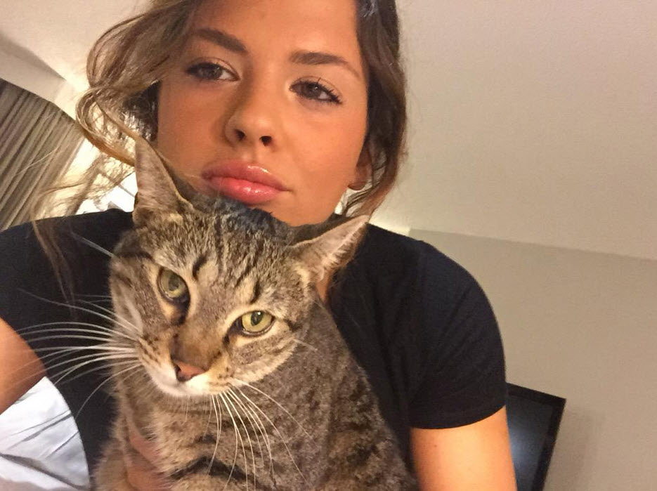 Keisha with her cat, Fritz. Courtesy of Keisha's Twitter @keishagreyxxx