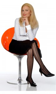 Candida Royalle in an orange chair